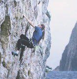 Woman rock climber on the cliff Royalty Free Stock Image