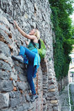 Woman rock climber on the cliff in the city Stock Photography