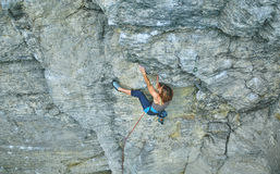 Woman rock climber on the cliff Stock Image