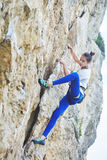 Woman rock climber on the cliff Royalty Free Stock Photo