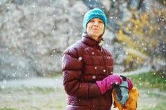 Woman rock climber preparing to climb Stock Image