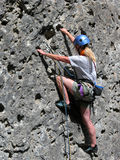 Woman rock climbing Stock Photos