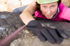 Woman rock climbing. On the nature royalty free stock images