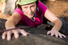 Woman rock climbing. On the nature stock photo