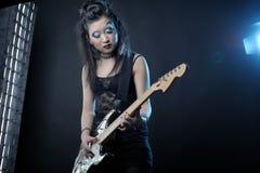 Woman rock with guitar Stock Photos