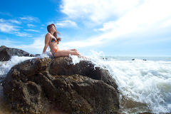 Woman on the rock in ocean Royalty Free Stock Image
