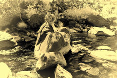 Woman on a rock Opalotype Stock Photography