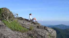 Woman on Rock Pan Right to Mountain View stock video footage