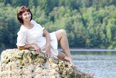 Woman on a rock Stock Image