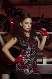 Woman in rock style clothing. Pretty woman in rock style clothing Stock Photo