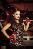 Woman in rock style clothing at the studio. Pretty woman in rock style clothing at the studio Stock Image