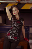 Woman in rock style clothing. Studio shot Stock Images