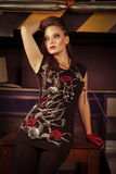 Woman in rock style clothing at the studio. Young woman in rock style clothing at the studio Royalty Free Stock Photos