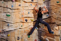 Woman on rock wall Stock Photo