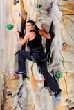 Woman on rock wall stock photos