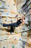 Woman on rock wall Royalty Free Stock Photography