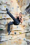 Woman on rock wall Royalty Free Stock Photos