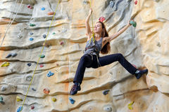 Woman on rock wall Stock Image