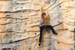 Woman on rock wall Royalty Free Stock Photo