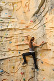 Woman on rock wall Royalty Free Stock Images