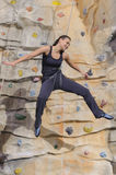 Woman on rock wall in sport centre Royalty Free Stock Photos