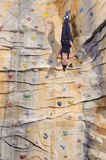 Woman on rock wall in sport centre Stock Photos