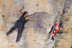Woman on rock wall in sport centre Royalty Free Stock Photography