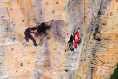 Woman on rock wall in sport centre Stock Photo