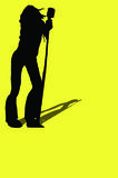 Woman rocker. A silhouette of a woman rocker with shadow and a yellow background Stock Image