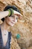 Woman among rocks Stock Photos