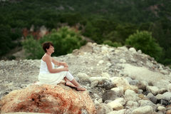 Woman on the rocks Royalty Free Stock Photo