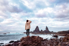 Woman on the rocky coast Stock Photos