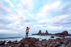 Woman on the rocky coast Royalty Free Stock Photos