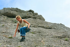 Woman on rocky hill Royalty Free Stock Image