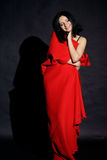 Woman rolled in red blanket Royalty Free Stock Photo