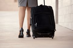 Woman with roller bag Royalty Free Stock Image