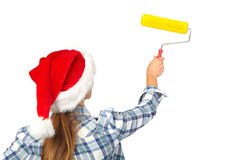 Woman with a roller. Christmas Royalty Free Stock Photography