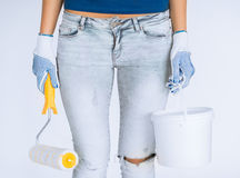 Woman with roller and paint pot Stock Photo