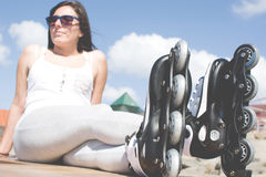 Woman with roller skate Stock Photography
