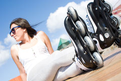 Woman with roller skate Royalty Free Stock Photos