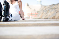 Woman with roller skate Royalty Free Stock Photography