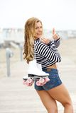 Woman roller skater smiling with thumbs up Royalty Free Stock Images