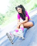 Woman on roller skates Stock Images