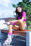 Woman on roller skates Stock Image