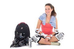 Woman in roller skates sitting with rucksack  isolated on white Stock Photo