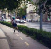 GIRL ROLLER SKATING IN THE CITY Stock Photo