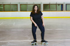 Woman roller skating with motion blur Stock Photo