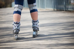 Woman roller skating outdoors Royalty Free Stock Photo