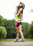Woman roller skating sport activity in park Stock Photos