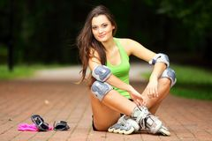 Woman roller skating sport activity in park Stock Image